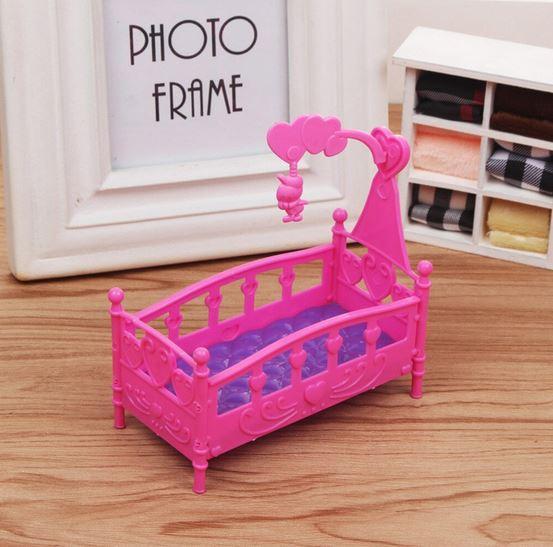 Игрушечная кроватка-качалка для малыша